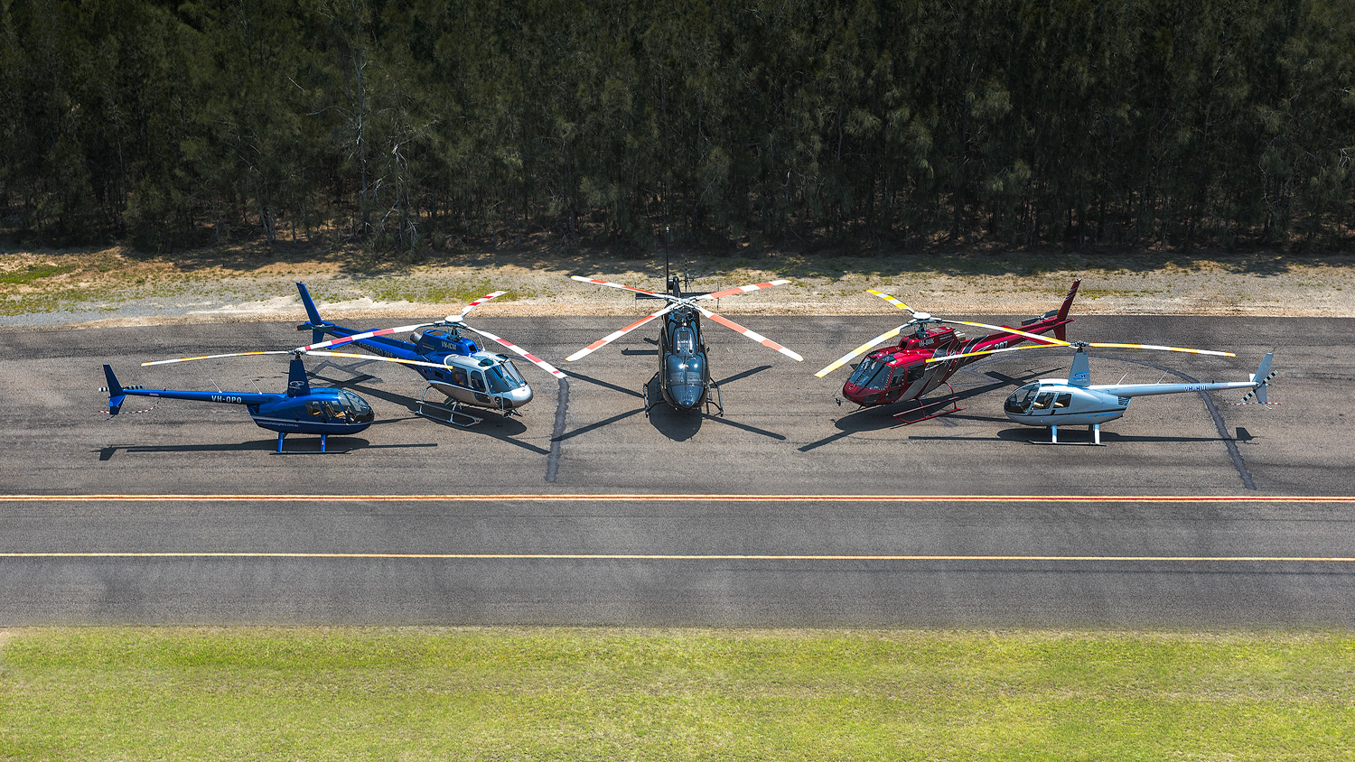 Compass Helicopter Safaris Australia - fleet at Cessnock Airport in the Hunter Valley. 2 Airbus AS350s 2 Robinson R44 and Bell 429 twin engine helicopter.